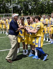 Jerry Snodgrass (left) of the OHSAA presents the Mariemont Warriors with the Division II Boys Lacrosse State Championship Trophy. June 3, 2017