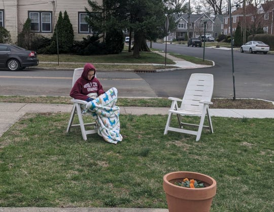 Maia Bidiak, senior at MSR, takes her online lessons outside to get some fresh air while learning at her home in Cranford.