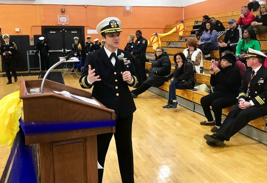 Commander Penny Glover, executive officer of Navy Recruiting District New York City, speaks during the NJROTC inspection ceremony at Linden High School. Glover led a team of service personnel who conducted the unit's annual inspection.