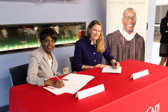 Atlantic Cape Community College President Dr. Barbara Gaba (left) and Thomas Edison State University President Dr. Merodie A. Hancock sign the agreement at the Atlantic Cape campus on Tuesday, March 3.