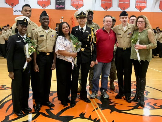 Three Linden High School NJROTC cadets who have committed to enter military service were honored along with family and supporters after the regiment's annual military inspection. They are Tamera Thorn, far left, who will enter the Marines; Ruben Rua, center, who will enter the Marines; and Patrick Hickey, right, who will enter the Army.