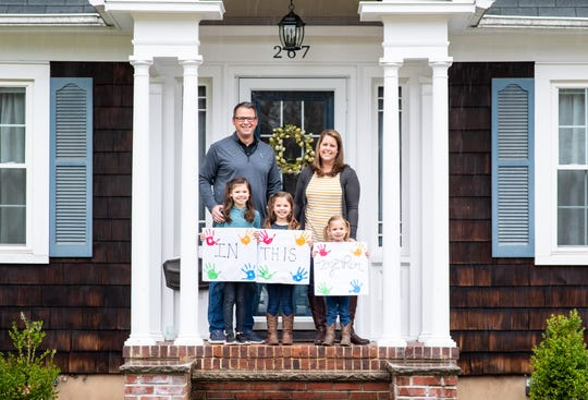 Photographer Rob Morris is volunteering to take family portraits during the coronavirus pandemic while adhering to social distancing guidelines as part of a fundraiser known as the Front Steps Project, which has become a nationwide movement