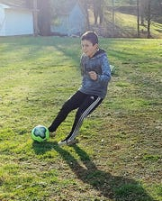Jax Lowe, 9, keeps his soccer skills sharp during the COVID-19 pandemic stay at home order. His mother, Rachelle Lowe of Kids America, said if even if you can't get outside because of weather soccer alternatives and more can be done inside.
