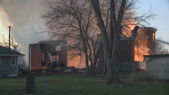 Firefighters battle flames at Pleasantville Christian Church on Monday, March 30, 2020, in Pleasantville, Iowa.