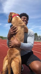 """Michigan State football senior linebacker Antjuan Simmons is at home with the ongoing coronavirus pandemic and finding different ways to work out apart from his Spartan teammates. """"This is Sam, and he's my running partner,"""" Simmons said. """"We do runs every other day."""" (Photo courtesy of Antjuan Simmons)"""