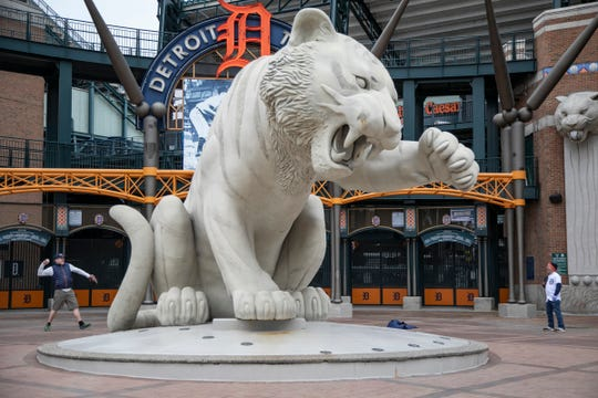 Hunter Chamberlain, 53, of Detroit, left, plays catch with his friend Mark Wolford, 58, of Portage Ohio Monday, March 30, 2020. The two had planned on attending Opening Day together but the MLB has postponed the start of the season leaving an empty Comerica Park in Detroit during a worldwide pandemic due to the spread of Coronavirus. The Detroit Tigers were to take on the Kansas City Royals for their home opener.