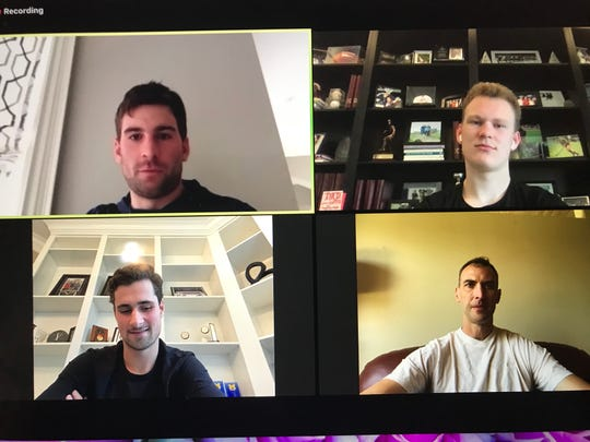 Detroit Red Wings' Dylan Larkin (bottom left) talks on a video conference with fellow NHL stars Monday, March 30, 2020.