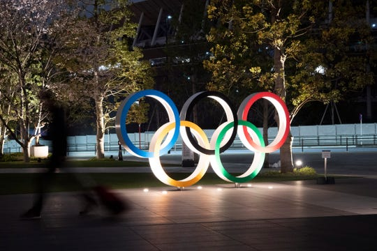 The Olympic rings are seen Monday in Tokyo.