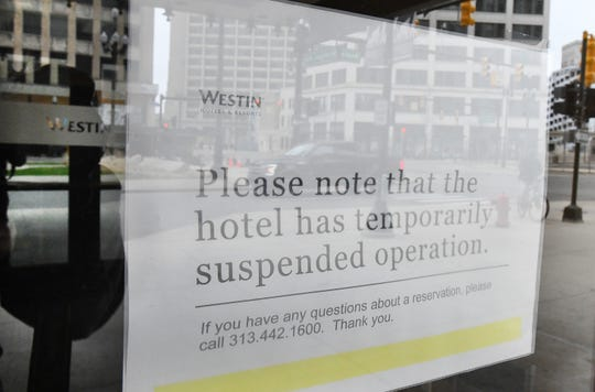 Signage on the front doors of the Westin Book Cadillac tells potential visitors that it has closed.