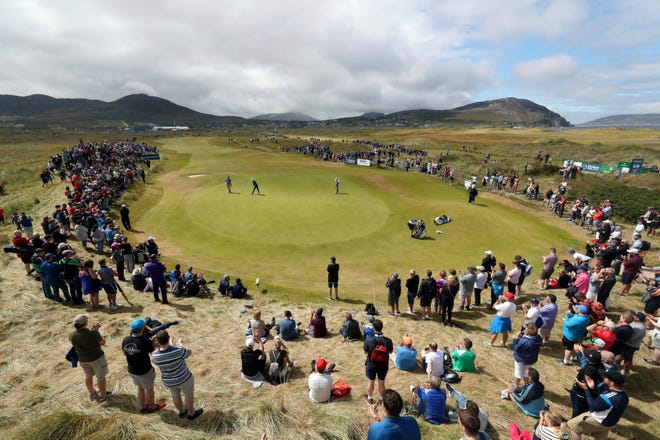 Crowds watch Northern Ireland's Rory McIlroy and England's Aaron Rai at the 2018  Irish Open in Ireland. The 2020 Irish Open has been postponed.