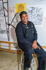 Artist and muralist Hubert Massey is lucky -- he's creating a prototype of an obelisk for a public-art project, which he can easily do at home.