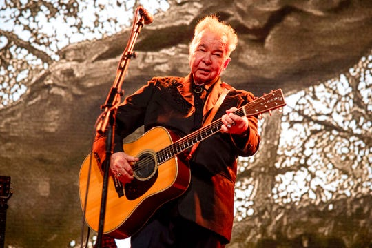 This June 15, 2019 file photo shows John Prine performing at the Bonnaroo Music and Arts Festival in Manchester, Tenn. The family of John Prine says the singer-songwriter is critically ill and has been placed on a ventilator while being treated for COVID-19-type symptoms.