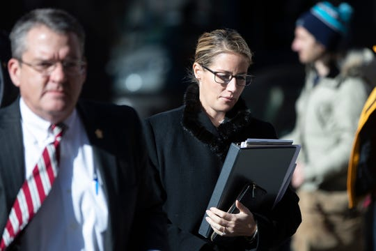 Attorneys for The Boy Scouts of America, Jessica Boelter, center, and Derek Abbott, left, return to their client's bankruptcy hearing in Wilmington, De., Wednesday, Feb. 19, 2020.