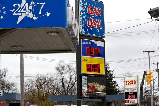 Gas at both stations across the street from each other are selling gas for 97.9 cents a gallon, Monday, March 30, 2020, in Cleveland. Oil started the year above $60 and has plunged on expectations that a weakened economy will burn less fuel. The world is awash in oil, meanwhile, as producers continue to pull more of it out of the ground.