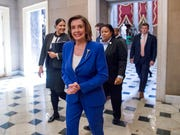 House Speaker Nancy Pelosi of Calif. walks to her office after signing the Coronavirus Aid, Relief, and Economic Security (CARES) Act after it passed in the House on Capitol Hill, Friday, March 27, 2020, in Washington.
