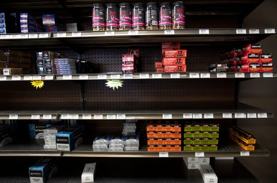 Ammunition sits on partially stocked shelves amid the coronavirus pandemic at USA Liberty Arms in Fort Collins, Colo. on Monday, March 30, 2020.