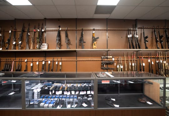 Firearms sit on partially stocked shelves at USA Liberty Arms in Fort Collins, Colo. on Monday, March 30, 2020. The Colorado Bureau of Investigation InstaCheck Unit is reporting extended wait times for background checks for firearms purchases and transfers.
