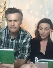 """Brendan Powers and Rachel Burttram Powers perform """"onstage"""" for Tiny Theatre. They stream performances three times a week from their Fort Myers storage closet."""