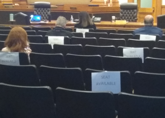Designated seats in Lee County Commission chambers  were used to make sure that all participants kept at least 6-feet apart while the commissioners got an update on efforts to reduce the probability for  spread of the COVID-19 virus.
