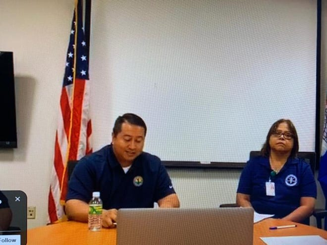 Commonwealth of the Northern Mariana Islands Gov. Ralph Torres and Commonwealth Healthcare Corp. Chief Executive Officer Esther Muna during a press conference on March 30, 2020.