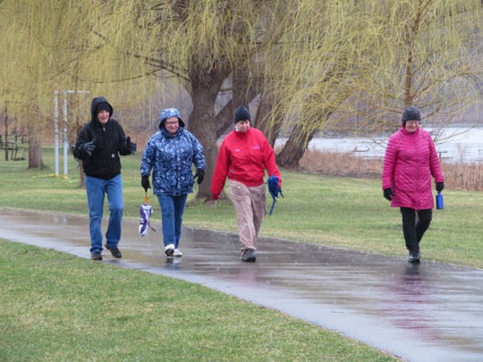Pictured left to right: Cortland residents Patty Francis, Pat Lane, Brenda Nobles and Jean Wittman take a walk at Stewart Park during the coronavirus pandemic.