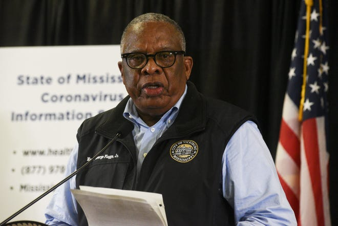 Mayor George Flaggs Jr. proclaims a civil emergency due to the spread of the COVID-19 coronavirus during a news conference at the Vicksburg Convention Center in Vicksburg, Miss., Sunday, March 22, 2020. Starting Monday at noon, measures such as a curfew, adjusted business hours, limitations on business services, social distancing and limitations on gatherings will be held for the next 14 days. (Courtland Wells/The Vicksburg Post via AP)