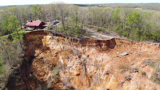 A landslide on Glendale Road in Hardin County now threatens to collapse a third home, seen at the upper left. A large portion of the hillside collapsed on March 28, 2020 after an initial landslide in February took out two homes and much of the road.