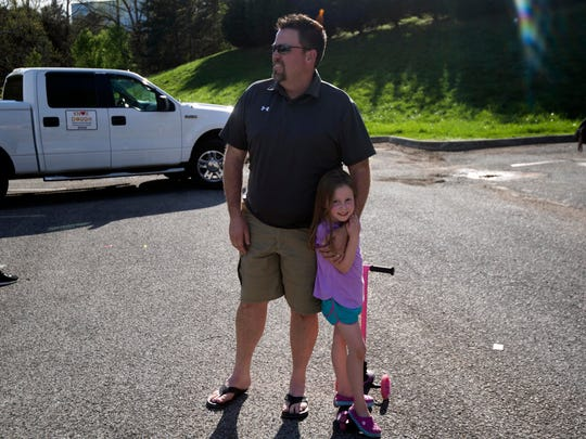 Jason Nipper, vice president of the Harrison Springs subdivision homeowners association, with daughter Avery on Sunday, March 29, 2020. Nipper helped organize a pop-up food truck park in the neighborhood for residents during self-quarantine.