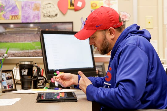 Josh Cox, a 6th grade math teacher at Wea Ridge Middle School, records a lesson for his students inside his classroom, Monday, March 30, 2020 in Lafayette.