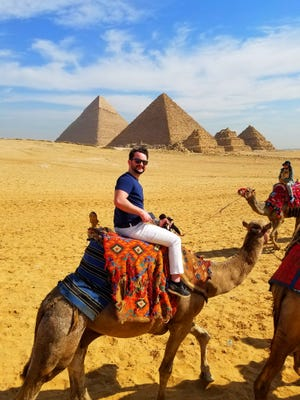 Tyler Muzzin rides a camel near the Giza pyramid complex in Egypt during a March 2020 vacation.
