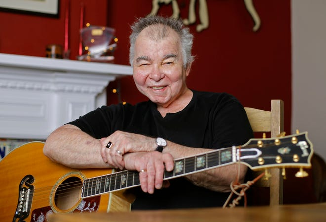 Singer-songwriter John Prine, shown here in 2017 in his office in Nashville, Tennessee, died Tuesday at age 73 from complications of the coronavirus.