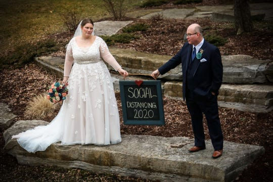 Becky and Mike Brown got married March 23 in East Lansing. The couple decided to marry that evening after Michigan's 'stay home, stay safe' order was issued in the morning, foregoing a planned ceremony with 120-guests that was planned for March 28.