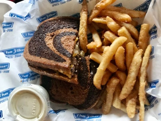 A patty melt with a side of french fries from The Bar in Green Bay.