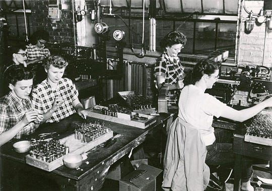 Women entered the workforce in droves. This photo shows women at work in one of the Aluminum Goods Manufacturing Company plants during World War II.