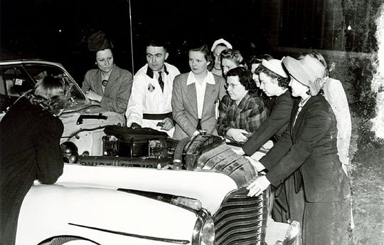 Female mechanics are pictured here in a World War II-era photo originally published in the Herald Times in May 1942.