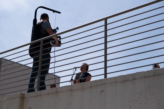 A cameraman records a benefit concert by Memphis-band Walrus on the roof of the Chisca building, Sunday, March 29, 2020, in Memphis.