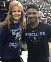 Memphis Grizzlies season ticket holder Joyce Ripley, left, poses for a photo with former Grizzly Bruno Caboclo.
