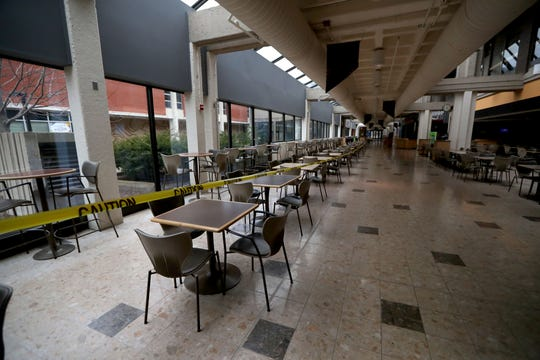 The dining area sits empty at the University of Milwaukee Wisconsin student union at the campus in Milwaukee on Wednesday, March 25, 2020. The stay at home order to stop the spread of the coronavirus has caused scores of local businesses and institutions to close leaving them empty.