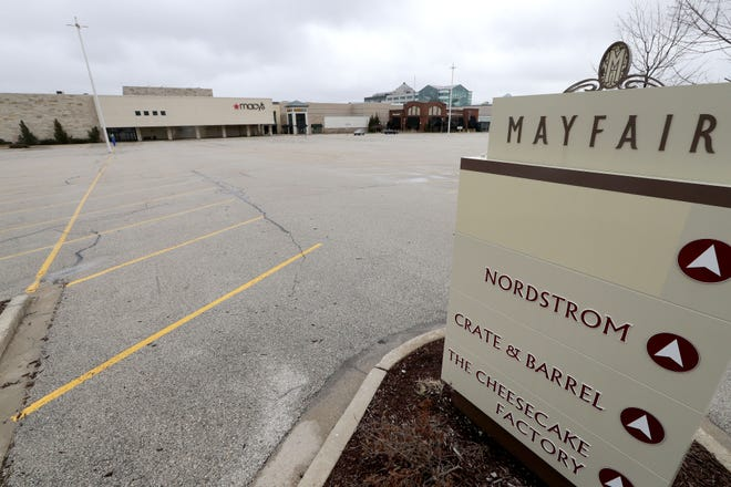 The Mayfair mall parking lot has remained empty since malls were shut down March 18 to stop the spread of the coronavirus. Some stores and restaurants at the mall are now offering curbside pickup options.