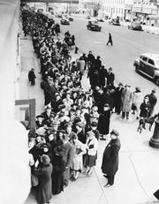 New Yorkers stand in line Feb. 23, 1943, to pick up their latest ration books.