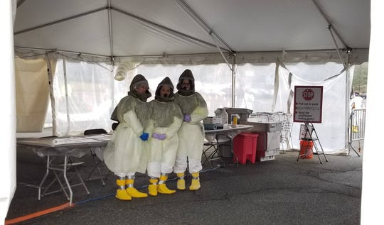 Medical professionals wear powered air-purifying respirator suits at Morris County's coronavirus testing center at County College of Morris.