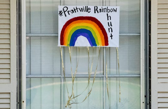 Teddy bears and rainbows are placed in windows around Prattville, Ala., as seen on Monday March 30, 2020 for the Bear Hunt, a way to help entertain neighborhood children.