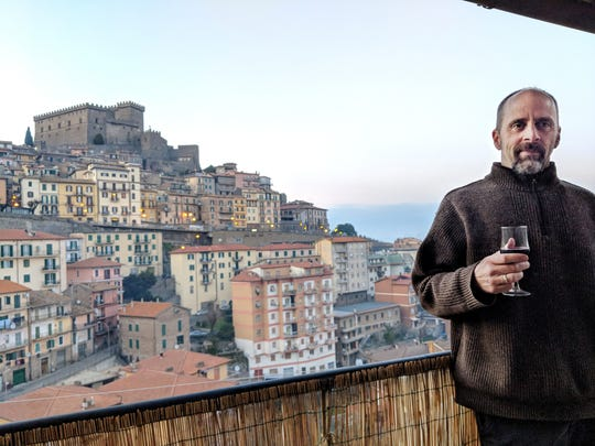 Matt Walker poses for a photo on his apartment balcony in Soriano nel Cimino, in the mountains north of Rome. He and his wife, Zeneba Bowers, -- both former Nashville Symphony orchestra musicians -- are on national quarantine there.