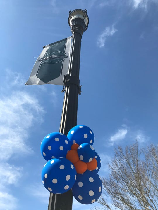 Decorative balloon shapes created by Devona Gamble that hang on light poles from Downtown Dickson to Charlotte in Dickson County.