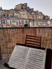 Sheet music on the apartment balcony of Zeneba Bowers and Matt Walker. The former members of the Nashville Symphony Orchestra moved to Italy four months ago, and they — like the rest of the country — are on national quarantine. They have been playing nightly concerts on their balcony to uplift their neighbors.