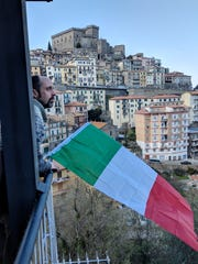 Matt Walker looks out from his apartment balcony in Soriano nel Cimino, in the mountains north of Rome.