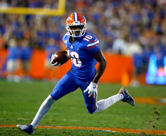 Florida Gators wide receiver Josh Hammond (10) runs with the ball after making a catch during the rivalry game against Florida State at Ben Hill Griffin Stadium in Gainesville on Nov. 30, 2019.