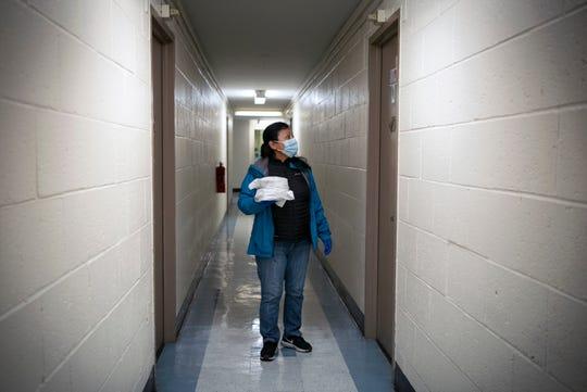 Volunteer Dora Valencia delivering meals to senior citizens in Paterson amid the coronavirus crisis.