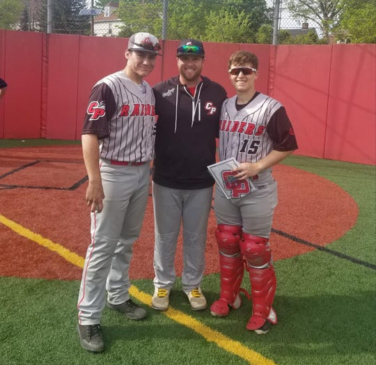 Cliffside Park baseball coach Ben Luderer, center, joined by his players last spring.