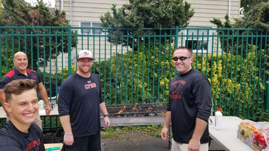 Cliffside Park baseball coach Ben Luderer, left, in cap, was always happy to volunteer his services at Red Raiders athletic events according to AD Dave Porfido